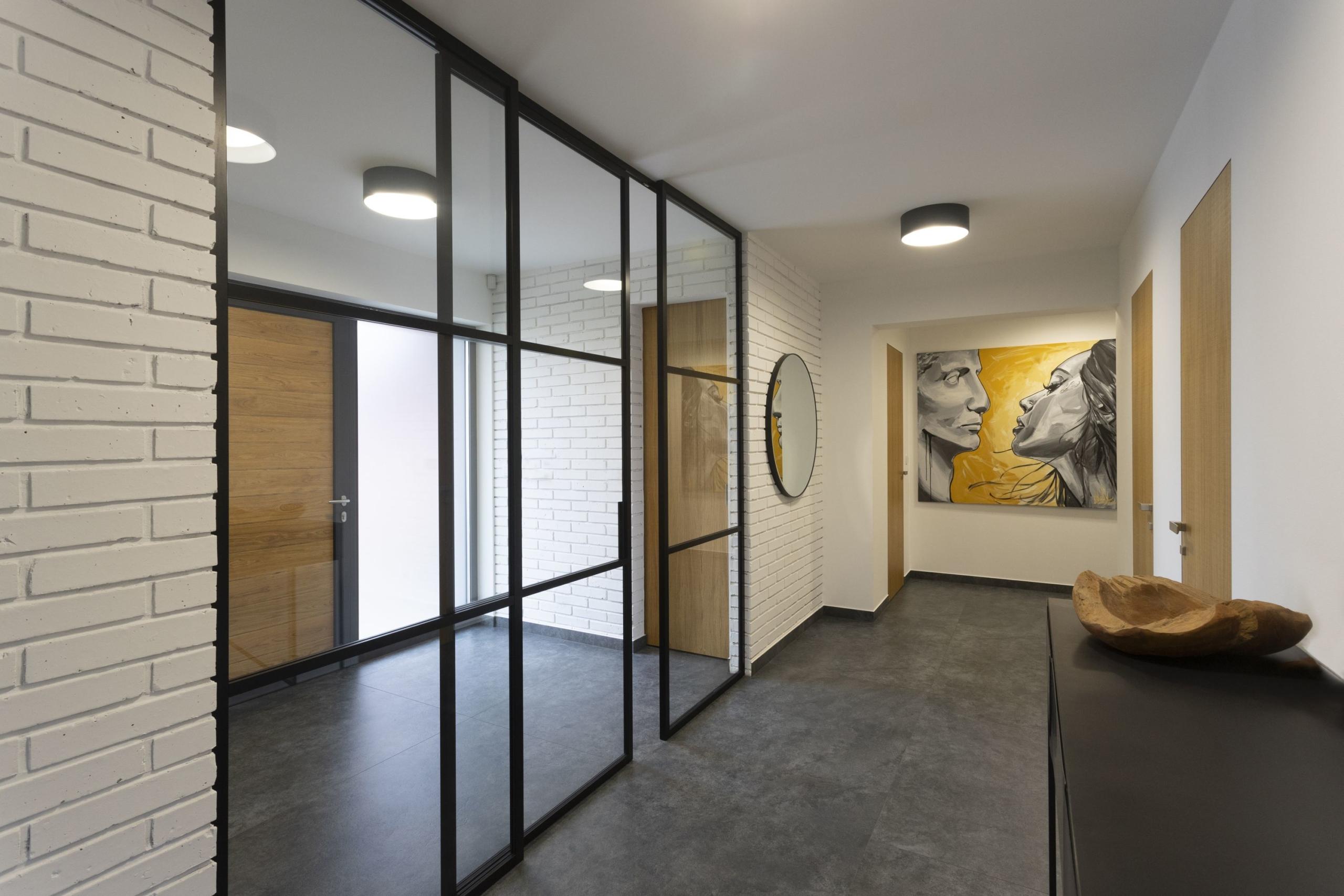 Posuvné dělící celoskleněné dveře